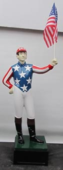 Jockey statues painted like US flag uncle sam statue