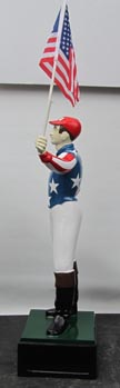 wrought aluminum lawn jockey Lawn jockey holding US flag American patriotic red white and blue painted jockey