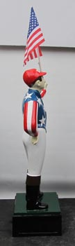 horse racing jockey statue red stripes blue stars horse racing jockey holding American flag