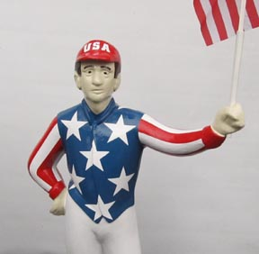 closeup red white blue horse racing jockey holding American flag 21 club usa flag jockey uncle sam